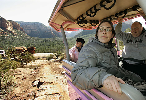 Linda Hinchman, left, of Ocean City, N.J., Thea Tremain, and Josh Klaff, both of Madison, Wis., take in the views during a Pink Jeep Tours Broken Arrow Tour in the Coconino National Forest in this Dec. 13, 2007 file photo in Sedona, Ariz.