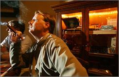 Tom Kolb, of Phoenix, Ariz., right, and Dale Sadlon, also of Phoenix, Ariz., enjoy a single malt scotch whiskey tasting at Magnum's Cigars, Wine & Spirits bar lounge in Phoenix.