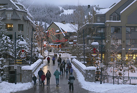 Skiers take some time off from the slopes to visit the Whistler Village in Whistler, British Columbia.