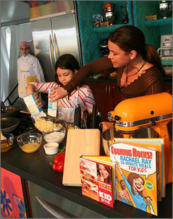 In Miami Beach: Rachael Ray shows kids how to cook at the South Beach festival.