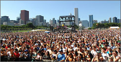 Fans watch bands perform at Lollapalooza during the music festival's first day at Chicago's Grant Park.