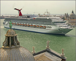 Carnival Cruise Lines' Carnival Liberty cruises down the Grand Canal in Venice, Italy.