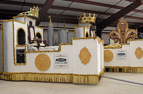 The king's and queen's Mardi Gras floats sit in the float-building warehouse of Doug Blom in Biloxi, Miss. Biloxi is celebrating 100 years of Mardi Gras parades.