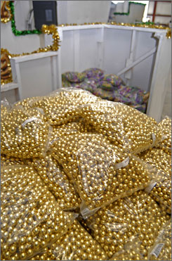Bags of gold Mardi Gras beads sit at the foot of the king's chair ready to be thrown to crowds.