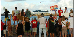 Sea and sky: Protesters greet the Hawaii Superferry on its approach to Nawiliwili Harbor in August while an airliner heads to Lihue Airport.