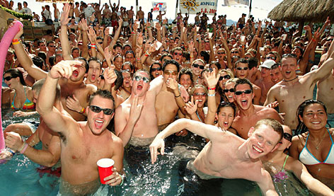 American spring breakers play at a swimming pool party in Acapulco, during the annual eight weeks of revelry as U.S. students descend upon popular beach resorts to let their hair down.