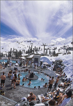 Best of both worlds: The Squaw Valley Ski Corp. shows skiers relaxing poolside at the Squaw valley USA resort in Olympic Valley, Calif.