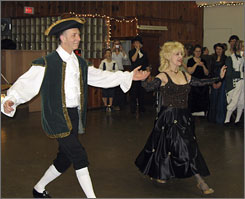 Professional dancers dance a stylized version of the Minuet at the King's Ball in Ste. Genevieve, Mo. The event is a 250-year-old tradition for the Missouri town, which was founded by the French in the 1700s.