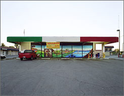 &quot;Re-inhabited Circle Ks (Phoenix), 2004-2006,&quot; by Paho Mann is part of the exhibition &quot;Worlds Away: New Suburban Landscapes,&quot; at the Walker Art Center in Minneapolis. The show displays 75 works ranging from architectural models of strip mall parking lots to large photographs of eerily empty mansions.