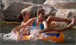 More than casinos: Teenagers Anne Brown, right, and Mikaela Lisoski of Portland, Ore., tube down the Truckee River Whitewater Park in Reno