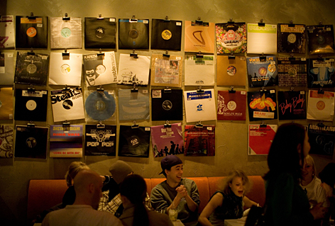 Buy your drinks and your discs: The walls at Vinyl are covered with records, which customers can take down, ask the DJ to play, and then purchase. The cocktails are all named after pop songs, too.