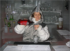 Cool customers: Bartender Esteri Lopponen pours a drink at Arctic Icebar, where the bar and tables are carved out of ice and the room is kept at 23 degrees.
