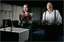 "Kate Fleetwood, left, and Patrick Stewart act in a scene from the Chichester Festival Theatre production of ""Macbeth"", currently at the Brooklyn Academy of Music's Harvey Theater. The production will play at Broadway's Lyceum Theatre  in New York City March 28-May 24."
