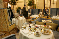 An afternoon tea service is displayed in the Palm Court during The Plaza hotel's reopening.