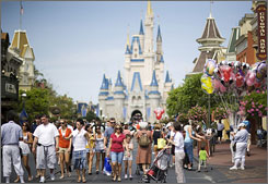 Guests walk along Main Street USA at the Walt Disney World Magic Kingdom in Orlando