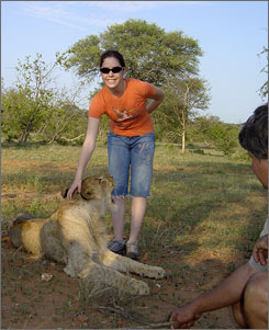Teen Ashley Kahn stands beside a 6 month-old male lion cub named Simba on a trip with People to People Student Ambassadors at Tshukudu Game Lodge in South Africa.