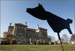 A canine decoy used to deter Canadian Geese is posted on the lawn in front of the Breakers mansion in Newport, R.I.