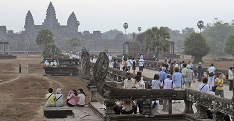 Tourists gather at Angkor Wat temple in Siem Reap, Cambodia, one of several iconic Asian destinations that have seen a surge in visitors in recent years.