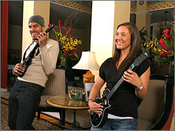 Rock and relax: Chris Couch and Samantha Arthur compete at Guitar Hero played via Microsoft Xbox at the Hotel Monaco Seattle's complimentary Friday social hours. 