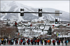 Participants line up for the start of the three legged ski race during the Steamboat Springs Winter Carnival in February. Prodigious snowfall across the country has let many resorts extend their closing dates and left the industry hoping this will be a record-setting season.