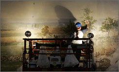 360-degree canvas: A conservator works on a section of the Battle of Gettysburg cyclorama  painting.