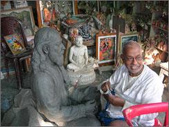 A sculptor prepares a statue in his workshop in the Kumartuli area of Calcutta.
