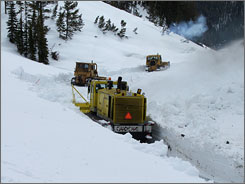 The park service works to clear Yellowstone's Sylvan Pass in April 2006. A spokesman said the park this winter may have had the most snowfall it has seen in seven to 10 years.