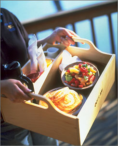 At Canoe Bay: An organic breakfast in a locally crafted wooden box is delivered to a guest's door.
