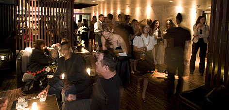Hot property: Guests mingle at a private party in the Bond Street sushi lounge in the new Thompson Beverly Hills hotel. Thompson co-owner Jason Pomeranc puts lively nightspots in his properties to create a buzz.