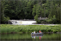 Two fisherman try their luck near the Lower Falls of the Tahquamenon Falls near Paradise, Mich. More than 80% of the state's tourism promotion dollars are being spent outside of Michigan.