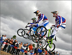 Exhibition race: Donny Robinson, left, Mike Day and Steven Cisar ride the BMX track at the training center.