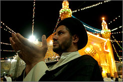 They keep coming: A sheik prays in the Shiite holy shrine of Imam Ali Mosque in Najaf, still a popular destination for Iranian Muslims. Iraqi tourism officials focus on these tourists, who haven't been kept away by violence.