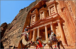 At Petra: Visitors to rose-red city ride camels near the Treasury, where our intrepid archaeologist uncovered the Holy Grail in Indiana Jones and the Last Crusade.