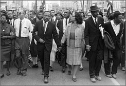 Dr. Martin Luther King Jr. and wife Coretta Scott King lead a march in Montgomery, Ala., in this 1965 photo.