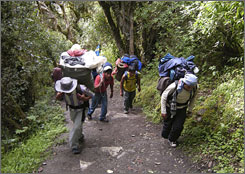 Porters on Peru's Inca Trail haul camping equipment and food for wealthy tourists for as little as $8 a day.