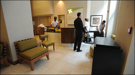 "Prep work: Getting the lobby area ready are, from left, Clement Dyer, general manager Peter McNamee, Aaron Warren and Johairo Graciano. ""Even our housekeepers are really excited about the new linens ... We have been preparing for over a year,"" McNamee said."