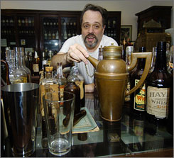 Curator Ted Haig shows off part of the antique liquor collection at the Museum of the American Cocktail in New Orleans in 2005.  The museum, which displayed some of its exhibits in a temporary space before Hurricane Katrina, opens in its permanent location July 21.