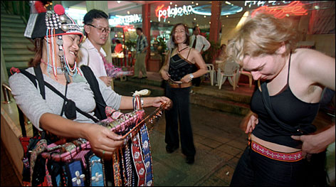 Tourists gather to buy souvenirs on Sukhumvit Road in Bangkok, Thailand. Although home to some of the most luxurious hotels in the world, the city also offers plenty of accomodations and activities for those on a budget.