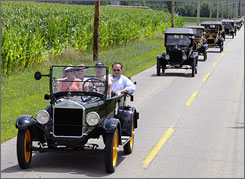 Parade of history: Ford Model T owners celebrate the vehicle's 100th anniversary in Richmond, Ind.