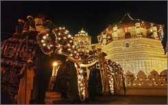 The real stars of the annual Esala Perahera procession are the elephants in elaborate costumes. Some carry important Buddhist monks and temple luminaries on their backs; others carry sacred artifacts in pagodas.