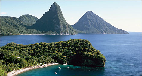 Volcanic origins: Gros Piton and Petit Piton are famous St. Lucia landmarks that tower over the ocean.