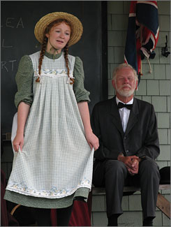 IN CAVENDISH: An actress portraying Anne Shirley, the heroine of the Anne of Green Gables books, performs at Avonlea Village. The commercial complex, which evokes the early 1900s, is a mix of historic and new buildings.