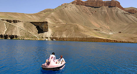 In central Afghanistan: Foreigners paddle on one of the six Band-i-Amir lakes, whose deep blue waters sparkle like jewels against the dusty mountains that surround them.