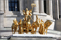 A gilded sculpture known as the Quadriga crowns the main entrance of the Minnesota State Capitol building in St. Paul.