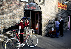 Leading edge: A Voodoo Doughnut employee starts his commute home. In 2007, Portland had the highest percentage of bicycle commuters, the U.S. Census shows.