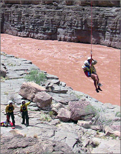 A stranded rafter is rescued from the Grand Canyon by the National Park Service on Aug. 17; flooding has had a devastating impact on tourism-related businesses in the middle of the summer season.