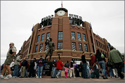 High on Colorado Rockies: Fans gather outside Coors Field, ready for some baseball, cold beer, great ballpark food and a view of the Rocky Mountains.