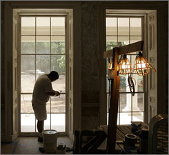 Restoration specialist James Quade works on triple hung windows in the drawing room of Montpelier. The restoration project removed several additions that had been made to the property since James Madison died in 1836.