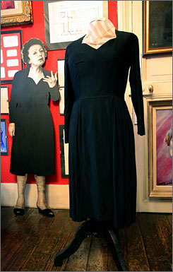 Piaf's famous little black dress is on display at the Edith Piaf museum in Belleville, along with gold and platinum records, photos and letters.