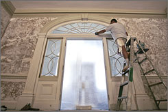 Precision: Restoration specialist Steve Bibb works on the entrance to the drawing room at Montpelier. Historians used clues left in the house and the builder's plans to re-create the look from Madison's days.